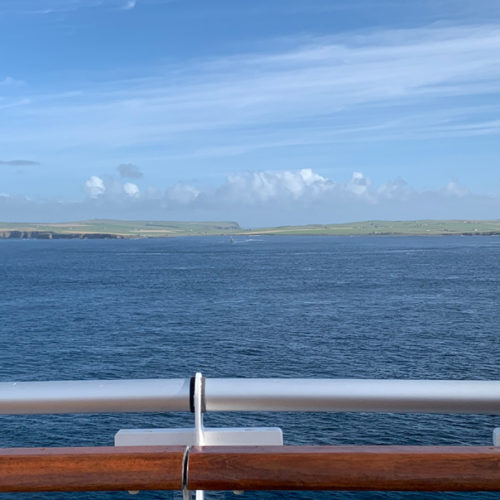 Sailing between Scotland's north shore and the Orkney Islands